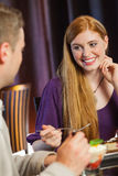 Gorgeous woman smiling at her husband during dinner Stock Images