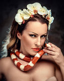 Gorgeous woman with snake Royalty Free Stock Image