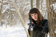 Gorgeous woman with a sniper rifle. Portrait of gorgeous young woman with a sniper rifle Royalty Free Stock Images