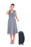 Gorgeous woman with suitcase suffering from headache Stock Images