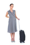 Gorgeous woman with suitcase suffering from painful back Stock Photo