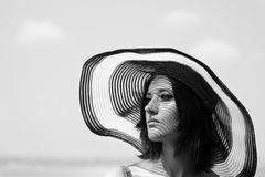 Gorgeous woman in sunhat Royalty Free Stock Photos
