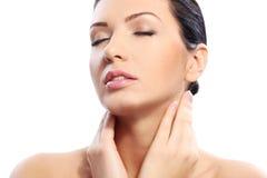 Gorgeous woman touching her beautiful face Stock Photos
