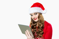Gorgeous woman using digital tablet to shop online Stock Photos