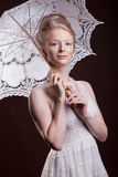 Gorgeous woman in victorian style holding a lace umbrella in han Royalty Free Stock Images