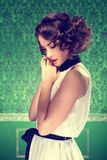 Gorgeous woman vintage toned image in retro room Stock Photos