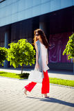 Gorgeous woman walking in mall. Outdoors shot of stylish young woman taking a walk to the mall Royalty Free Stock Images