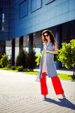 Gorgeous woman walking in mall. Outdoors shot of stylish young woman taking a walk to the mall Stock Image