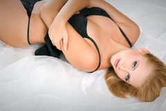 Gorgeous woman wearing erotic black lingerie Stock Photography
