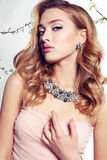 Gorgeous woman wears elegant lace dress and luxurious necklace Royalty Free Stock Photos