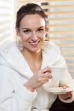 Gorgeous woman in white bathrobe with toothy smile. Portrait of a gorgeous woman in white bathrobe with toothy smile Stock Photos