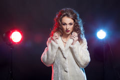 Gorgeous woman in winter fur with two light behind Royalty Free Stock Photography