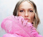 Gorgeous Woman With A Pink Feathers Royalty Free Stock Photo