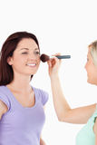 Gorgeous Women applying make-up Stock Image