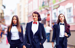 Gorgeous women in black walking the city street Royalty Free Stock Photos