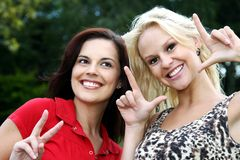 Gorgeous Women Showing Happy Signs Royalty Free Stock Photography