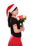 Gorgeous Xmas girl holding flowers bouquet Stock Photo