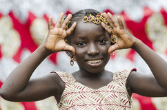 Gorgeous young African girl showing palms as peace symbol portrait Royalty Free Stock Photography