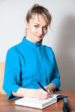 Gorgeous young beautiful doctor working in the office Stock Photos