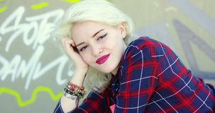 Gorgeous young blond hipster woman stock footage
