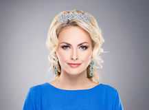 Gorgeous, young blond wearing a sapphire crown and earrings Stock Photo