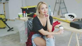 Trendy female sitting at carpenter workbench stock footage