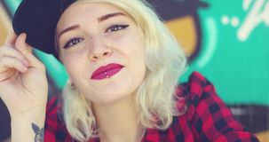 Gorgeous young blond woman with a pierced lip stock footage
