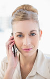 Gorgeous young blonde businesswoman calling with mobile phone Stock Photos