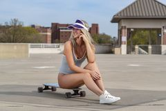 Gorgeous Young Coed Model Enjoying The Warm Weather With Her Skateboard stock image