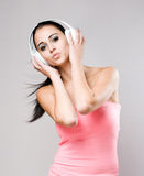 Gorgeous young brunette enjoying music. Stock Images