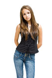 Gorgeous young brunette girl posing in jeans. Royalty Free Stock Photography