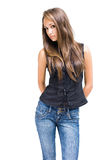 Gorgeous young brunette girl posing in jeans. Stock Photo
