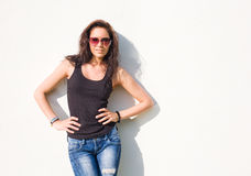 Gorgeous young brunette in hot summer sunshine. Royalty Free Stock Photography