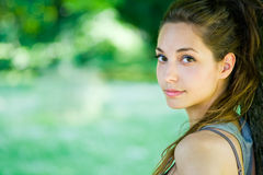 Gorgeous young brunette in the park. Stock Photo