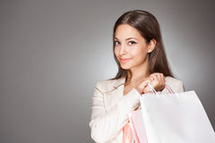 Gorgeous young brunette shopper. Royalty Free Stock Image