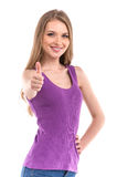 Gorgeous young brunette showing big thumbs up. Stock Photo