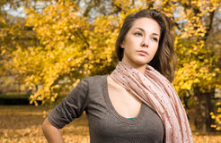 Gorgeous young brunette strolling in the park. Royalty Free Stock Photo