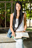 Gorgeous young brunette student. Stock Photos