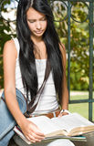 Gorgeous young brunette student girl outdoors. Stock Photos