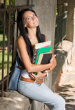 Gorgeous young brunette student girl outdoors. Royalty Free Stock Photography