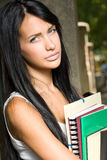 Gorgeous young brunette student girl outdoors. Royalty Free Stock Photo
