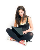 Gorgeous young brunette using laptop. Royalty Free Stock Photo