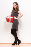 Gorgeous young brunette woman with gift box. Royalty Free Stock Photos