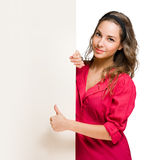 Gorgeous young brunette woman showing thumbs up. Royalty Free Stock Photo