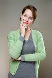 So.. Gorgeous young brunette woman standing in pondering posture Stock Images