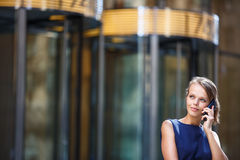 Gorgeous young businesswoman calling on her phone Royalty Free Stock Photography