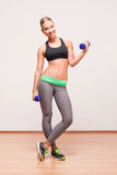 Gorgeous young fitness woman. Royalty Free Stock Photography