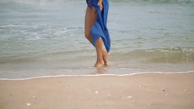 Gorgeous young girl with a beautiful figure posing and walks along the seashore. In a blue swimsuit light shirt. European appearance. vietnam nha trang stock footage