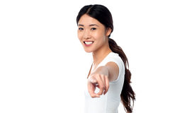 Gorgeous young girl pointing you out Royalty Free Stock Photos