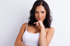 Gorgeous young girl with shrewd and sly glance Stock Photography